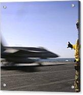 A Sailor Ensures An Fa-18c Hornet Acrylic Print by Stocktrek Images