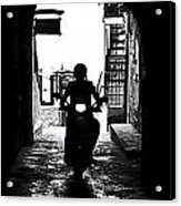 a scooter rider in the back light in a narrow street in Italy Acrylic Print