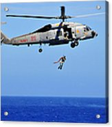 A Search And Rescue Swimmer Is Lowered Acrylic Print
