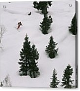 A Skier Makes His Way Down A Hill Acrylic Print