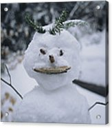A Smiling Snowman With Twig Arms Acrylic Print
