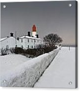 A Snow Covered Fence With A Lighthouse Acrylic Print by John Short