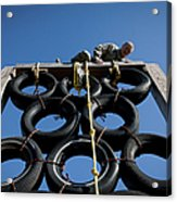 A Soldier Climbs Over A Tire Tower Acrylic Print
