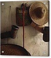 A Straw Hat, Straw Baskets And A Belt Acrylic Print