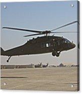 A Uh-60 Black Hawk Landing Acrylic Print