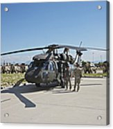 A Uh-60l Blackhawk Parked On Its Pad Acrylic Print
