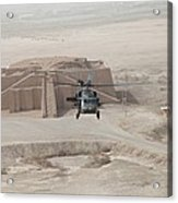 A Us Army Black Hawk Helicopter Hovers Acrylic Print