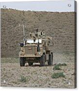 A U.s. Army Cougar Patrols A Wadi Acrylic Print
