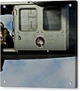 A U.s. Navy Naval Air Crewman Guides Acrylic Print