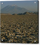 A Volcano Rises Above A Dry Lake Bed Acrylic Print