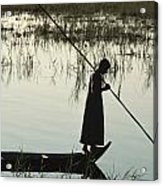A Woman Stands At The End Of A Rowboat Acrylic Print by Lynn Abercrombie