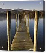 A Wooden Dock Going Into The Lake Acrylic Print