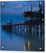 A Wooden Pier With Lights On It At Acrylic Print