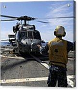 Airman Signals To An Mh-60s Sea Hawk Acrylic Print