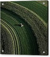 An Aerial View Of A Tractor On Curved Acrylic Print