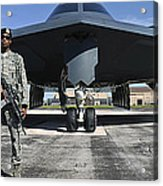 An Airman Guards A B-2 Spirit Acrylic Print