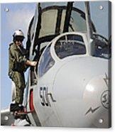 An Airman Makes A Final Look Over An Acrylic Print