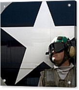 An Airman Stands In Front Of A C-2a Acrylic Print