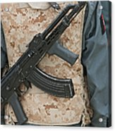 An Ak-47 Rests On The Sling Of An Acrylic Print