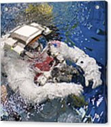 An Astronaut Is Submerged In The Water Acrylic Print by Stocktrek Images