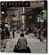 An Elderly Woman Pushes A Cart Acrylic Print by Justin Guariglia