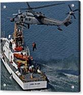 An Hh-60g Pave Hawk Performs A Hoist Acrylic Print