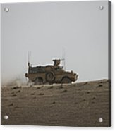 An Mrap Vehicle Patrols The Ridge Acrylic Print