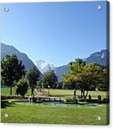 An Open Field In Interlaken With A View Of The Mountains In The Background Acrylic Print