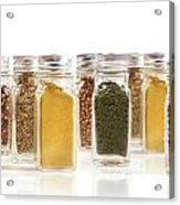 Assorted Spice Bottles Isolated On White Acrylic Print by Sandra Cunningham