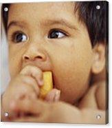 Baby Boy Eating Acrylic Print by Ian Boddy