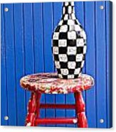 Blach And White Vase On Stool Against Blue Wall Acrylic Print