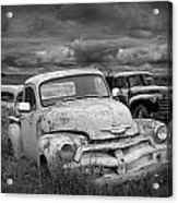 Black And White Photograph Of A Junk Yard With Vintage Auto Bodies Acrylic Print