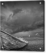 Boat Stranded On A Beach Covered By Menacing Storm Clouds Acrylic Print