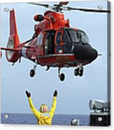 Boatswain Mate Directs A Hh-65a Dolphin Acrylic Print by Stocktrek Images