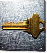Brass Key On Stainless Steel. Acrylic Print by Ballyscanlon