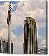Buildings And Flags Against Sky Acrylic Print