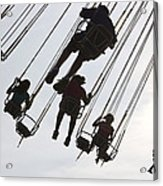 Carnival Goers Enjoy A Ride At An Acrylic Print
