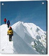 Climbers Hike Along A Ridge Acrylic Print