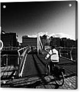 Commuter Cycling Over The Tradeston Bridge Pedestrian Bridge Over The River Clyde To The Financial D Acrylic Print