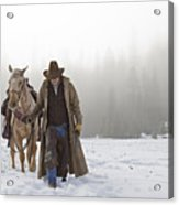 Cowboy Walking His Horse And Holding A Shotgun Acrylic Print by Thomas Kokta