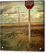 Deserted Red Stop Sign On The Prairies Acrylic Print by Sandra Cunningham