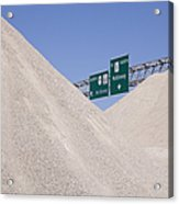 Dirt Mounds With Highway Signs In Background Acrylic Print by Jeremy Woodhouse