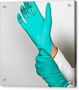 Doctor Putting On Gloves Acrylic Print