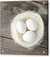 Eggs In Nest On Wooden Counter Acrylic Print