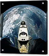 Elevated View Of A Spacecraft Orbiting Over The Earth Acrylic Print