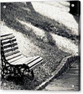 Empty Park Bench On Edge Acrylic Print by (c) Conrado Tramontini