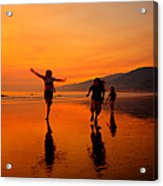 Family Running In The Beach At Sunset Acrylic Print