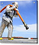 Firefighter Carries A Charged Hose Acrylic Print