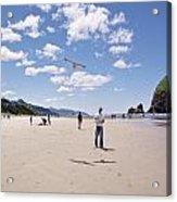 Flying A Bird Kite Near Haystack Rock Canon Beach Oregon Usa Acrylic Print