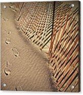 Footprints On The Beach Along A Fence Acrylic Print